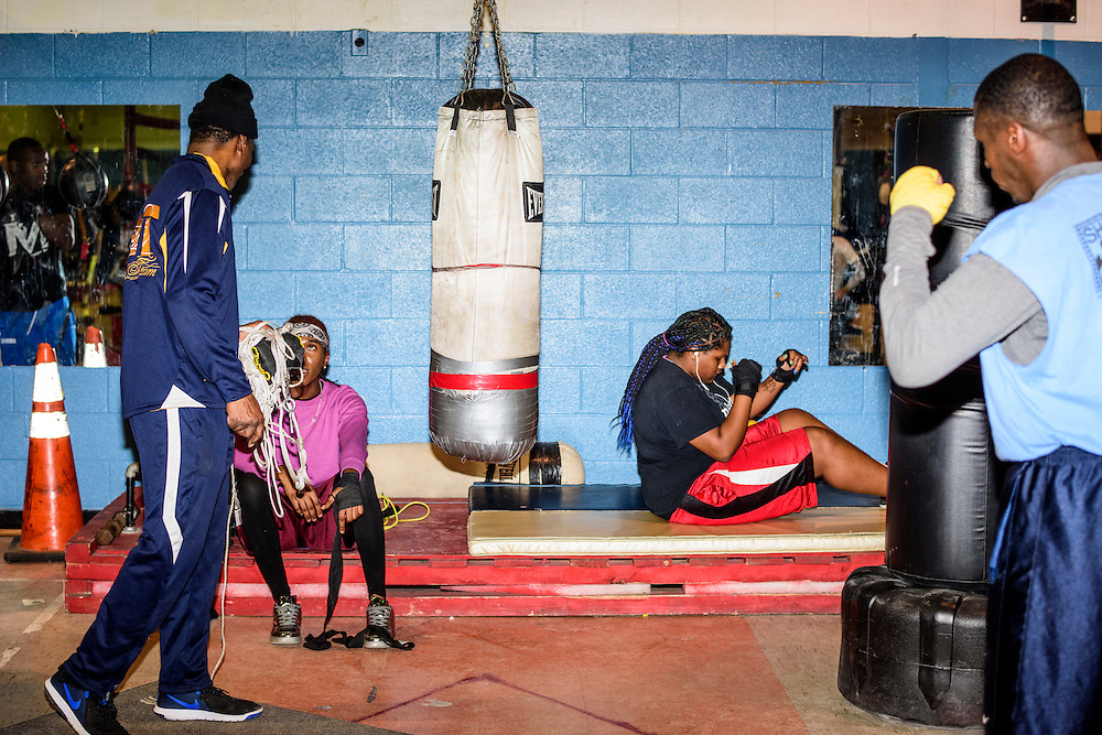 Baltimore, Maryland - January 26, 2017: Coach Calvin Ford talks with Jack Moore, 21, at the Upton Boxing Club in Baltimore. Aalliyeh Clinton, 16, trains middle right.<br /> <br /> <br /> CREDIT: Matt Roth for The New York Times<br /> Assignment ID: