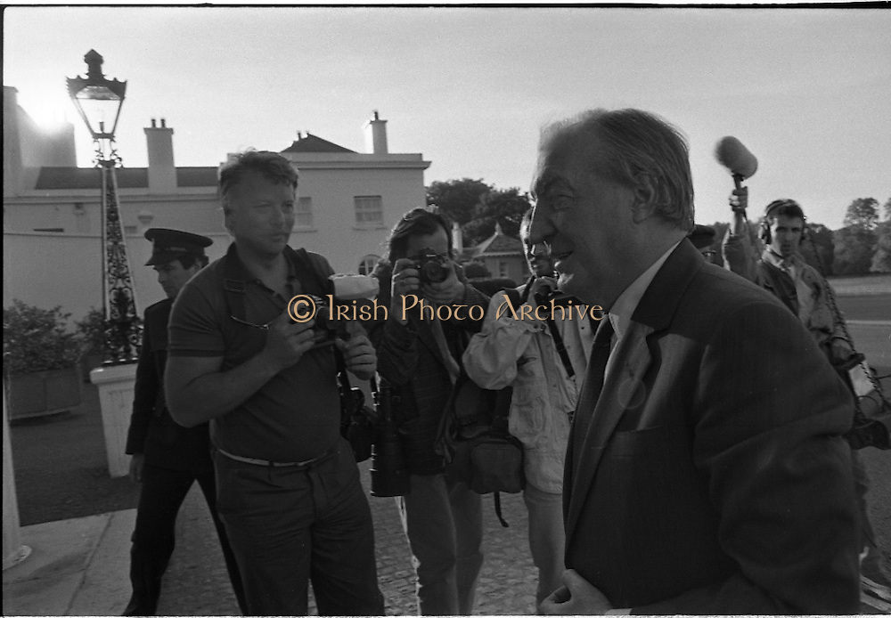 Dissolution Of The 25th Dáil.  (S4)..1989..25.05.1989..05.25.1989..25th May 1989..At the request of An Taoiseach,Mr Charles Haughey TD, President Patrick Hillery agreed to sign the order for the dissolution of the 25th Dáil. Fianna Fáil the outgoing government held the majority at 81 seats. This signing formally began the general election campaign for the 26th Dáil...An Taoiseach, Mr Charles Haughey TD, is pictured arriving at Áras an Uachtaráin for the signing of the order to dissolve the 25th