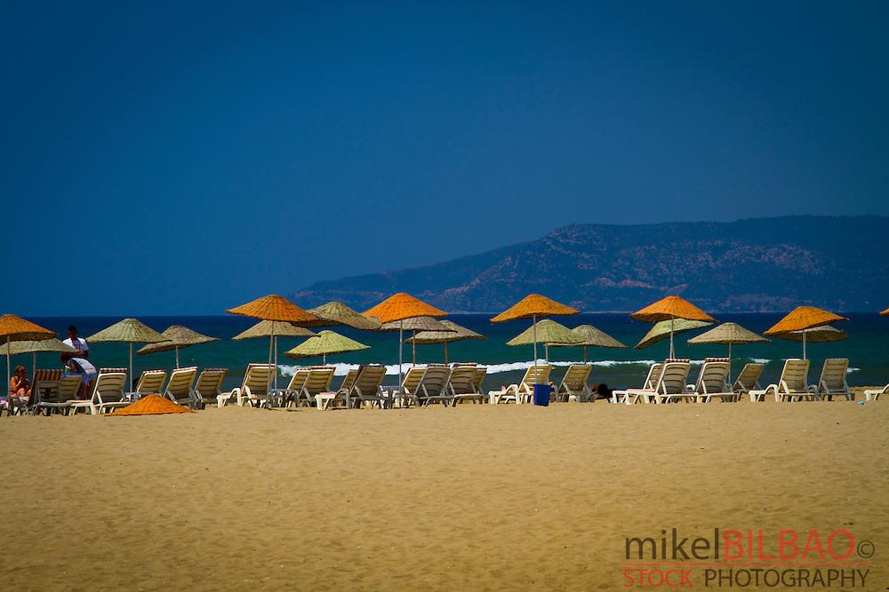 Parasols in Selcuk-Ephesus (Pamucak) beach.<br /> Aegean coast. Izmir province. Turkey
