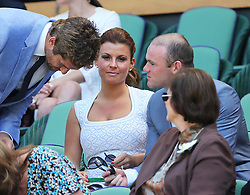Wayne and Coleen Rooney talk to Gerard Butler in the Royal Box for the Men's Final at the Wimbledon Tennis Championships in  London, Sunday, 7th July 2013<br /> Picture by Stephen Lock / i-Images