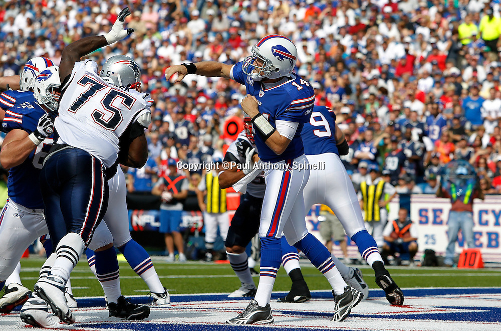 Buffalo Bills quarterback Ryan Fitzpatrick (14) throws a pass with New England Patriots defensive tackle Vince Wilfork (75) pressuring during the NFL week 3 football game against the New England Patriots on Sunday, September 25, 2011 in Orchard Park, New York. The Bills won the game 34-31. ©Paul Anthony Spinelli