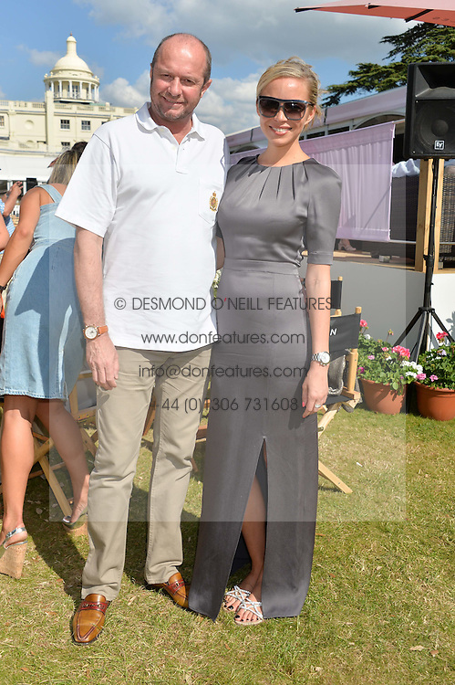 SCOT YOUNG and NOELLE RENO at the Summer Solstice Party during the Boodles Tennis event hosted by Beulah London and Taylor Morris at Stoke Park, Park Road, Stoke Poges, Buckinghamshire on 21st June 2014.