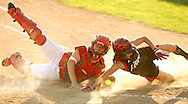 Cedar Rapids Washington catcher Sam Short tags out Linn-Mar's Kortlan Olinger at the plate during their 4A Regional softball game at Jefferson High School in Cedar Rapids on Saturday, July 10, 2010. Linn-Mar won 9-1.