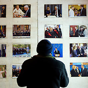 December 18, 2013 - Kiev, Ukraine: A man looks at a wall decorated with pictures of Ukraine's jailed former Prime Minister, Yulia Tymoshenko, near Independence Square.<br /> On the night of 21 November 2013, a wave of demonstrations and civil unrest began in Ukraine, when spontaneous protests erupted in the capital of Kiev as a response to the government&rsquo;s suspension of the preparations for signing an association and free trade agreement with the European Union. Anti-government protesters occupied Independence Square, also known as Maidan, demanding the resignation of President Viktor Yanukovych and accusing him of refusing the planned trade and political pact with the EU in favor of closer ties with Russia.<br /> After a days of demonstrations, an increasing number of people joined the protests. As a responses to a police crackdown on November 30, half a million people took the square. The protests are ongoing despite a heavy police presence in the city, regular sub-zero temperatures, and snow. (Paulo Nunes dos Santos/Polaris)