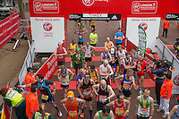 Club runners cross the finishing line at the Virgin Money London Marathon, Sunday 26th April 2015.<br /> <br /> Scott Heavey for Virgin Money London Marathon<br /> <br /> For more information please contact Penny Dain at pennyd@london-marathon.co.uk