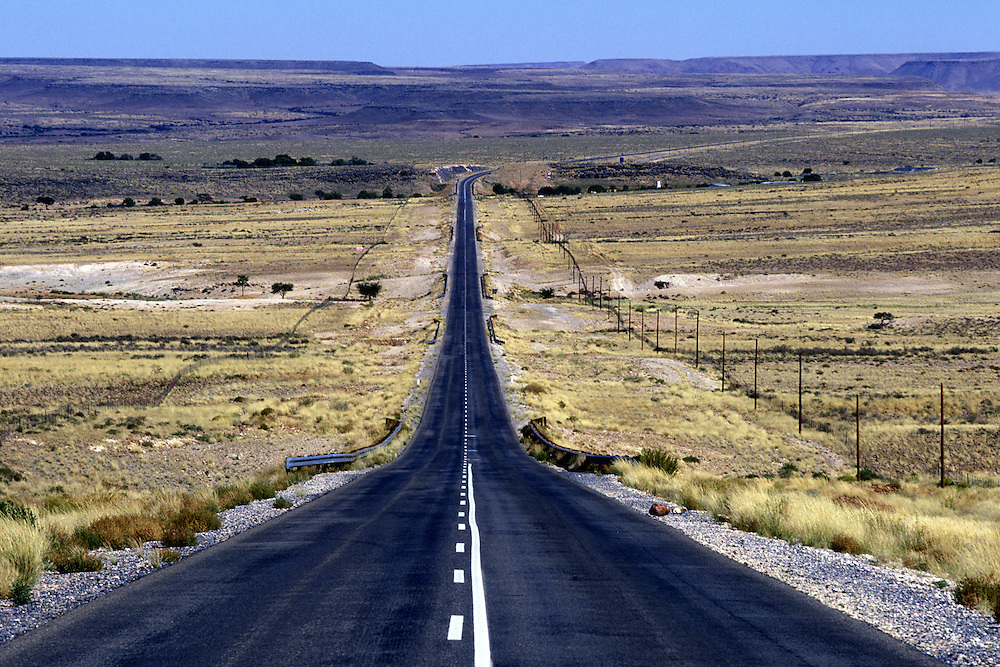 Africa, Namibia, Keetmanshoop, Empty highway passes through Namib Desert