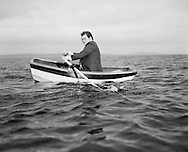Businessman rowing boat (B&W)