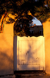 An arched gateway in Santa Fe, New Mexico.