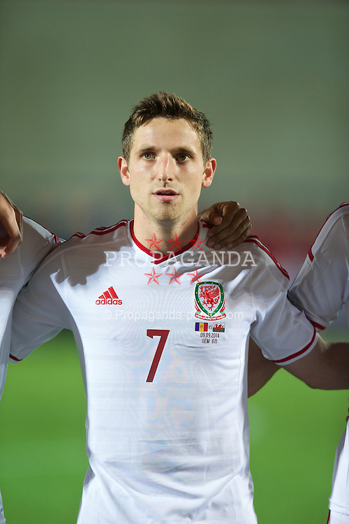 ANDORRA LA VELLA, ANDORRA - Tuesday, September 9, 2014: Wales' Joe Allen lines-up before the opening UEFA Euro 2016 qualifying match against Andorra at the Camp d'Esports del M.I. Consell General. (Pic by David Rawcliffe/Propaganda)