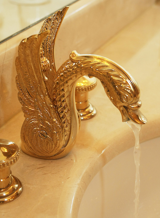 Gold swan faucets are featured in the bath room of the  Four Season's 2200 square foot presidential suite rents for $ 4,000 a night featuring a full kitchen.