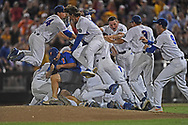 Players of the Florida Gators celebrate after defeating the LSU Tigers 6-1 to win the National Championship at the College World Series at TD Ameritrade Park in Omaha, Nebraska.