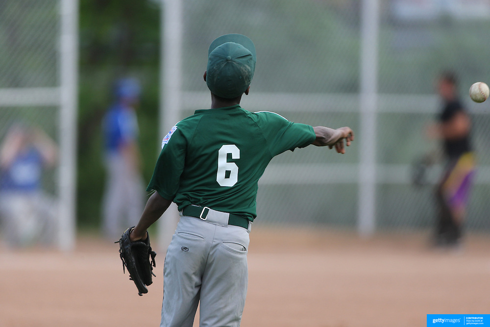 An outfielder throws the ball in during the Norwalk Little League baseball competition at Broad River Fields,  Norwalk, Connecticut. USA. Photo Tim Clayton