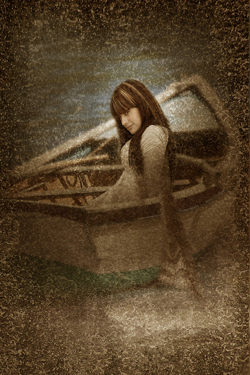 A young woman sitting alluringly in a rowing boat with added texture