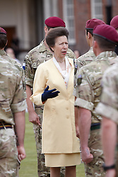 © licensed to London News Pictures. LONDON, UK  02/06/2011. The Princess Royal (pictured in yellow) hands out campaign medals to soldiers from 216 (Parachute) Signal Squadron during a ceremony at Royal Hospital Chelsea watched by friends, family and Chelsea Pensioners. The Squadron recently returned from a 6 month tour of Afghanistan and is responsible for communications links between soldiers and commanders. A thanksgiving service was given in honour of Cpl Steven Dunn who was killed during the tour. Please see special instructions for usage rates. Photo credit should read CLIFF HIDE/LNP