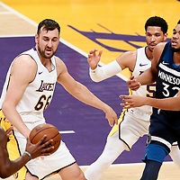 25 December 2017: Minnesota Timberwolves center Karl-Anthony Towns (32) passes the ball to Minnesota Timberwolves guard Jimmy Butler (23) during the Minnesota Timberwolves 121-104 victory over the LA Lakers, at the Staples Center, Los Angeles, California, USA.
