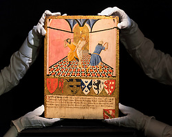"""© Licensed to London News Pictures. 02/12/2016. London, UK.   Technicians show """"Flagellation"""" by Master of the Osservanza, known as Sano di Pietro, a 15th century, Italian gold-ground 'gabella' panel, (est. GBP 400-600k), at a preview of Sotheby's upcoming Old Masters Evening Sale in New Bond Street. Photo credit : Stephen Chung/LNP"""