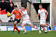 Glen Rea (16) Luton Town FC defender and Harry Middleton (14) Doncaster Rovers midfielder  during the EFL Sky Bet League 2 match between Doncaster Rovers and Luton Town at the Keepmoat Stadium, Doncaster, England on 18 February 2017. Photo by Ian Lyall.