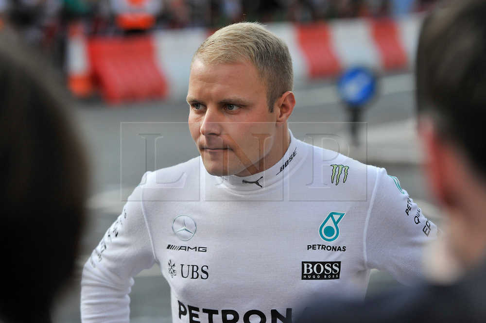 © Licensed to London News Pictures. 12/07/2017. London, UK.   Valteri Bottas meets the public ahead of taking part in a parade of Formula One cars around a circuit passing Trafalgar Square and Whitehall during a promotional event called F1LiveLondon ahead of the British Grand Prix at Silverstone.   Photo credit : Stephen Chung/LNP