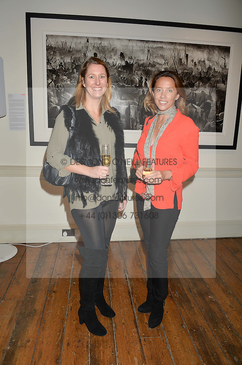 Left to right, LAURA SPEARS and SAMANTHA WICKENS at a private view of photographs by renowned wildlife photographer David Yarrow in aid of TUSK entitled 'Wild Encounters' held at Somerset House on 19th September 2016.