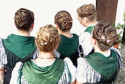 Members of Buching, Germany's town band congregate before the parade with an array of beautiful braided hairstyles.