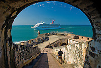 Cruise ship entering the bay of San Juan viewed from an El Morro archway