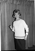 09/03/1964<br /> 03/09/1964<br /> 09 March 1964<br /> McBirney's Fashion show at McBirney's, Aston Quay, Dublin. Model Blanche showing a pink/black jumper and black skirt from collection.