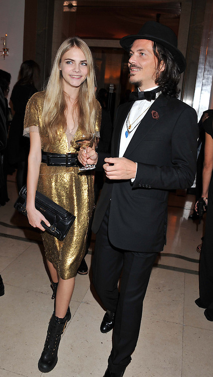 CARA DELEVINGNE and MATTHEW WILLIAMSON at the Harper's Bazaar Women of the Year Awards 2011 held at Claridge's, Brook Street, London on 7th November 2011.