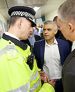 Sadia Khan at London's Night Tube launch at Brixton tube station, London, Great Britain <br /> 19th August 2016 <br /> <br /> Paul Crowther - BTP Chief Constable talks to Sadia Khan - Mayor of London <br /> Mike Brown TFL - Commissioner<br /> <br /> <br /> Sadia Khan, mayor of London,  launched the first night tube service and travelled on a tube train between Brixton and Walthamstow on the Victoria Line. <br />  <br /> He launched the first 24 hour Friday and Saturday night services on the Central and Victoria lines <br /> <br /> Photograph by Elliott Franks <br /> Image licensed to Elliott Franks Photography Services