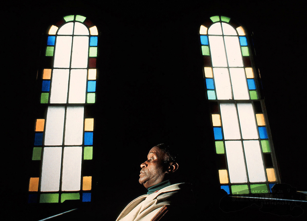Photo by Gary Cosby Jr.  A pastor sits in his church in Elizabeth City, N.C.  The pastor was active in the Civil Rights movement.