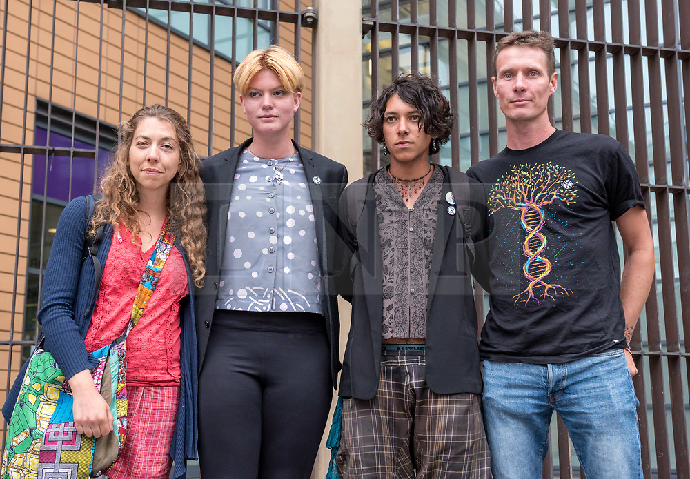 "© Licensed to London News Pictures. FILE PICTURE dated 04/09/2019. Bristol, UK. File picture of four of the ""Bathtub Five"" at Bristol Magistrates Court who have been found guilty of obstructing a highway and each given a 12 month conditional discharge and told to pay court costs between £180 and £250. left - right: Dr CHRISTELLE BLUNDEN, IMOGEN PHILLIPS, ELLIOTT CUCIUREAN, TIMOTHY MILLER. It is reported today, 19/09/2019, that 14 members of Extinction Rebellion including the four above have been sentenced following earlier trials at Bristol Magistrates Court for obstructing a highway, all being given conditional discharges and told to pay court costs. They were accused of blocking traffic on Newfoundland Road at the end of the M32 with a pink bathtub on 17 July 2019 during Extinction Rebellion's five-day 'occupation' of Bristol, part of a country-wide week of rebellion called Extinction Rebellion Summer Uprising, holding protests in five cities across the UK. Some protestors attached themselves to a bathtub placed in the road and had to be removed by a specialist police team, disrupting traffic for much of the day. The defendants said their action was to draw attention to the climate emergency. Photo credit: Simon Chapman/LNP."