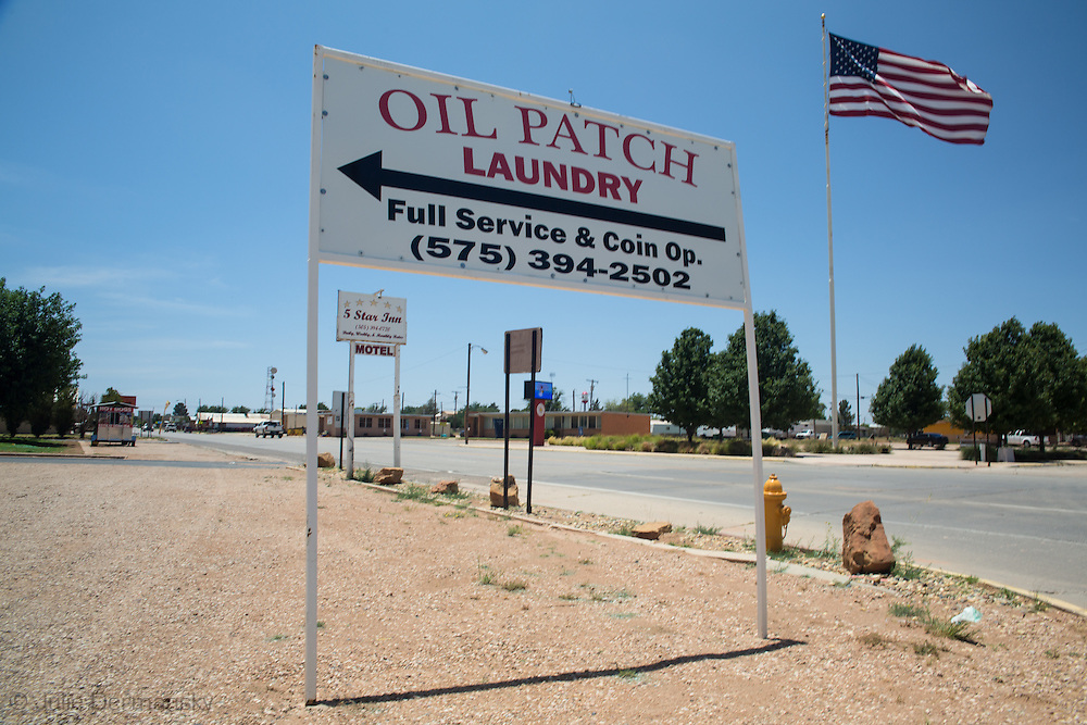 Sign for a a laundry mat in Eunice New Mexico, an area the south eastern part of the state, experiencing an oil boom due to the fracking industry.