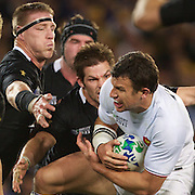 Damien Traille, France, is tackled by Richie McCaw, and Brad Thorn, (left) New Zealand, during the New Zealand V France Final at the IRB Rugby World Cup tournament, Eden Park, Auckland, New Zealand. 23rd October 2011. Photo Tim Clayton...