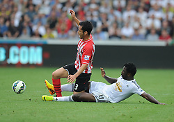 Swansea City's Wilfried Bony fouls Southampton's Maya Yoshida which causes Swansea City's Wilfried Bony to get his second yellow and get sent off. - Photo mandatory by-line: Alex James/JMP - Mobile: 07966 386802 20/09/2014 - SPORT - FOOTBALL - Swansea - Liberty Stadium - Swansea City v Southampton  - Barclays Premier League