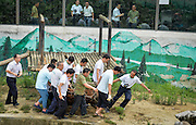 CHENGDU, CHINA - JUNE 19: (CHINA OUT) <br /> <br /> Emergency Drill Held At Chengdu Zoo<br /> <br /> Rescuers participate in an emergency drill supposing that tourists fall into bear's enclosure by accident at Chengdu Zoo on June 19, 2014 in Chengdu,<br /> ©Exclusivepix