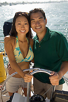 Couple embracing on boat (portrait)