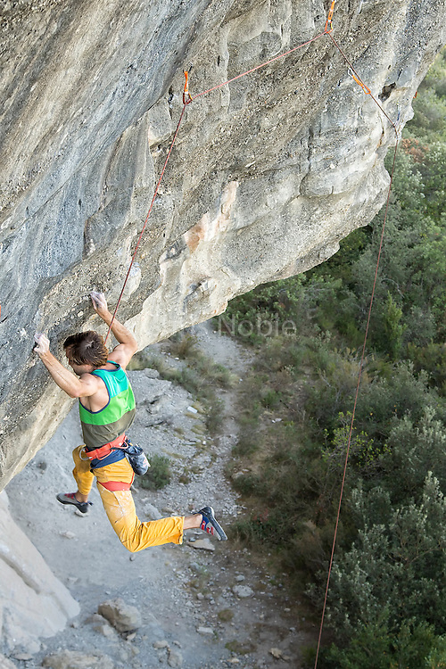 Chris Sharma working on a new project, a traverse, at Cova de Ocell near Barcelona Spain