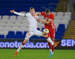 CARDIFF, WALES - Monday, September 9, 2019: Belarus' Kiryl Piachenin (L) and Wales' substitute Chris Gunter during the International Friendly match between Wales and Belarus at the Cardiff City Stadium. (Pic by David Rawcliffe/Propaganda)