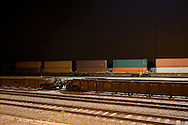 Nighttime descends on the small intermodal yard in Schiller Park, IL, with only a few lights to illuminate the scene.