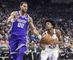 December 29, 2017 - Sacramento, CA, USA - The Sacramento Kings' Willie Cauley-Stein (00) defends against the Phoenix Suns' Josh Jackson (20) as he drives to the basket on Friday, Dec. 29, 2017, at the Golden 1 Center in Sacramento, Calif. (Credit Image: © Hector Amezcua/TNS via ZUMA Wire)