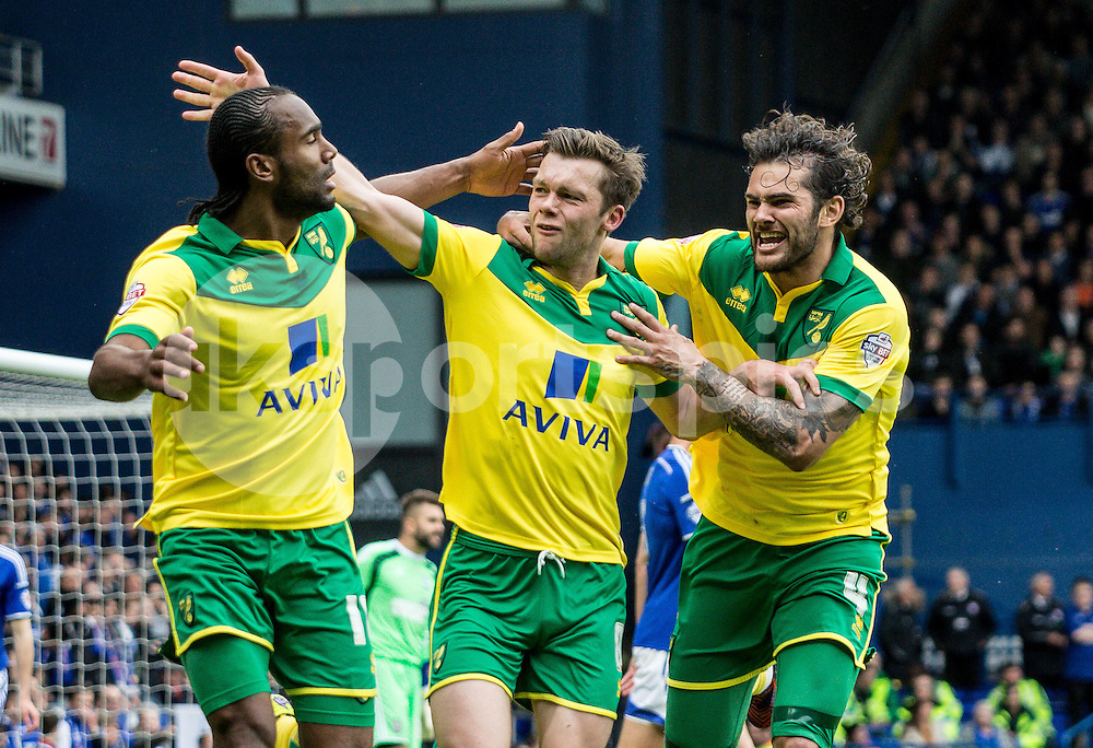 Jonathan Howson of Norwich City celebrates his goal with Cameron Jerome of Norwich City and Bradley Johnson of Norwich City during the Sky Bet Championship Play Off 1st Leg match between Ipswich Town and Norwich City at Portman Road, Ipswich, England on 9 May 2015. Photo by Liam McAvoy.