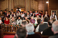 "Judy Buswell leads the chorus inviting guests to singalong to ""Count Your Blessings"" during Singing the Old Time Religion at the Methodist Advent Christian Church in Lakeport on Sunday afternoon.  (Karen Bobotas/for the Laconia Daily Sun)"