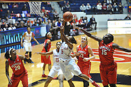 """Georgia Bulldogs forward Krista Donald (15) blocks a shot by Mississippi Lady Rebels guard Erika Sisk (5) at the C.M. """"Tad"""" Smith Coliseum in Oxford, Miss. on Thursday, January 15, 2015.  (AP Photo/Oxford Eagle, Bruce Newman)"""