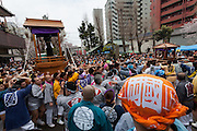 Festival supporters carry mikoshi or portable shrine with large phallus on them  in to Kanayama Shrine near the end of the Kanamara Matsuri, (Festival of the Steel Phallus). Kawasaki Daishi, Kanagawa, Japan. Sunday April 3rd 2016. The famous Kawasaki Penis Festival started in 1977 as a small festival to celebrate an old legend about the defeat of a penis eating demon. Today the festival is a huge draw for Japanese and foreign tourists and raises money for HIV and AIDS research.