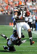 Cleveland returner Josh Cribbs returns a kickoff 92 yards for a touchdown as Corey Ivy misses a tackle in the first quarter.