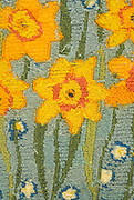Detail of tapestry with daffodils