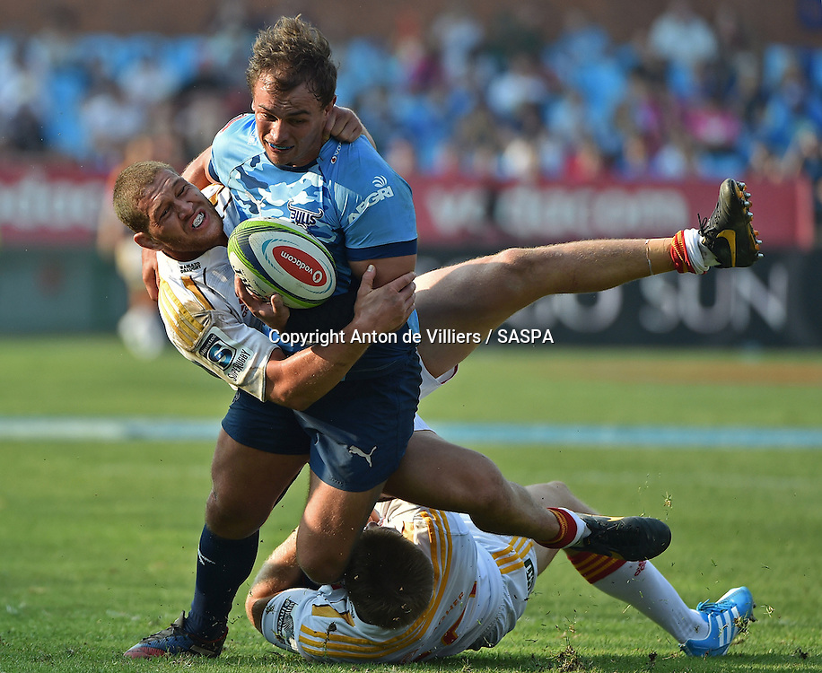 PRETORIA, South Africa, 29 MARCH 2014 : Deon Stegmann of the Bulls powering forward with Tawera Kerr-Barlow of the Chiefs on his back during the Vodacom Super Rugby match between the VODACOM BULLS and the CHIEFS at Loftus Versfeld in Pretoria, South Africa on 29 MARCH 2014. The game ended in a 34 all draw.<br /> <br /> &copy; Anton de Villiers / SASPA