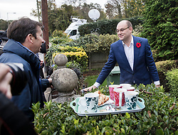 © Licensed to London News Pictures. 09/11/2017. Whitam, UK. Alex Sawyer (R), husband of Priti Patel, talks to reporters after bringing out a tray of tea and cake. Priti Patel resigned from government yesterday. Photo credit: Peter Macdiarmid/LNP