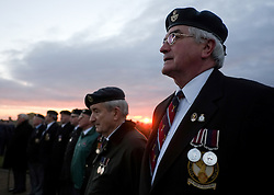© Licensed to London News Pictures. <br /> 16/12/2014. <br /> <br /> Hartlepool, United Kingdom<br /> <br /> Veterans stand together as they take part in a sunrise memorial event to commemorate the bombardment of Hartlepool by German warships during World War One. During the bombardment 130 civilians were killed and more than 500 were wounded. The Headland's Heugh Gun Battery returned fire in what was the only battle to be fought on British soil during World War One, and one of the Battery's soldiers, Theo Jones of the Durham Light Infantry, became the first British soldier to be killed by enemy action on home ground in the war.<br /> <br /> Photo credit : Ian Forsyth/LNP