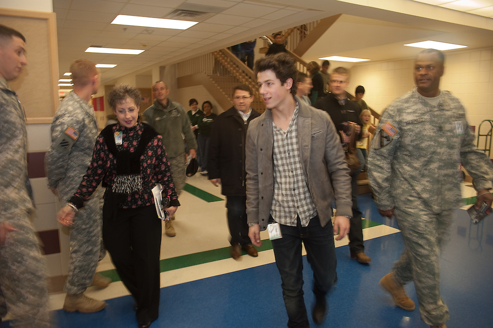 "Mark Matson For USO (12/11/09)  The USO hosted a ""Community Strong"" event at Ft. Hood, Friday December 11, 2009. Singer Nick Jonas made an appearance at Meadows Elementary School. Principal Karol Carlisle and 1SG Anthony Iglehart escort Jonas to a school assembly."