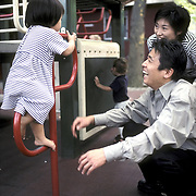 Asian ( Japanese ) American family @ playground with smaill daughter, Queens NY